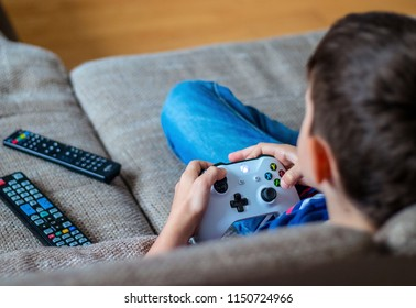 VIENNA, AUSTRIA - MAY 4th, 2018: Kid boy playing Xbox One. Xbox One is a line of eighth generation home video game consoles developed by Microsoft.