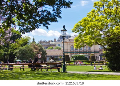 VIENNA, AUSTRIA - MAY 6, 2012: Some people enjoy a sunny recreational day at the Stadtpark Vienna with the Kursalon a historic and former music hall in the 18th century