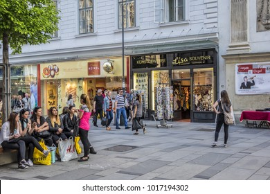 VIENNA, AUSTRIA - MAY 7, 2016: People relax and go shopping at Carinthian Street. Carinthian Street (Kaerntner Strasse) is most famous shopping street in central Vienna. Storefronts of famous brands.