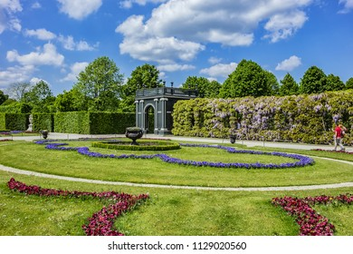VIENNA, AUSTRIA - MAY 8, 2016: Beautiful Schonbrunn Palace garden (opened to public in 1779) and Kammergarten pavilion. Schoenbrunn palace - former imperial summer residence.