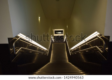 Vienna, Austria: May/20/2019 - Vienna International Airport (built in 1938 and the largest airport in Austria). Beautiful and unique illuminated steps design.