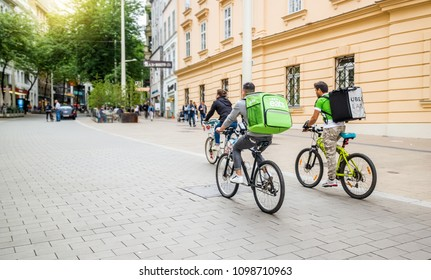 Vienna Austria May.25 2018, Uber Eats is an International food delivery company from U.S, Cyclist caring backpacks