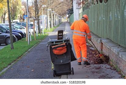 VIENNA, AUSTRIA - NOVEMBER 10, 2015: man is sweeping outdoor in Vienna Austria