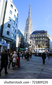 VIENNA, AUSTRIA - NOVEMBER 14, 2015 - People walk along Graben street which is best known as Vienna's most elegant shopping street. There has St. Stephen Cathedral in the heart of old town.