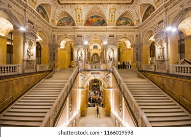 Vienna, Austria - November, 2017: Illuminated sumptuous staircase in imposing interior of the famous Naturhistorisches Museum with statues and round arches.
