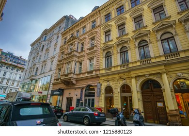 VIENNA, AUSTRIA - NOVEMBER 2017: Urban view of architectural buildings in baroque style walking by the historic center of Vienna city in Austria, Europe.