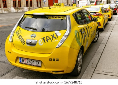 VIENNA, AUSTRIA - NOVEMBER 2019: Electric taxi cab parked behind other taxis on a street in Vienna city centre.
