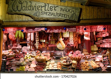 VIENNA, AUSTRIA - NOVEMBER 21: Christmas Market at Rathausplatz in November 21, 2013 in Vienna, Austria. Kiosk selling  huge selection of traditional  meat products.