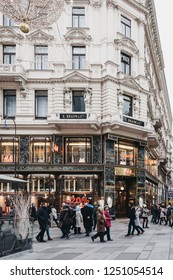 Vienna, Austria - November 24, 2018: People walking past H&M store on Graben, Vienna. It is one of the most famous streets in Vienna's first district for shopping, sightseeing and architecture.