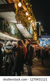 Vienna, Austria - November 24, 2018: People browsing Christmas decor at Christmas World on Rathausplatz, traditional Christmas Market in Vienna with over 150 booths offering food, drinks and crafts.