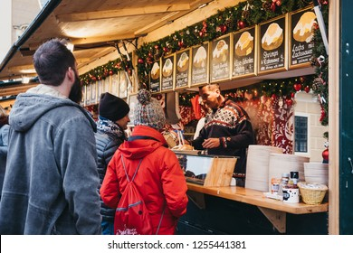 Vienna, Austria - November 25, 2018: People buying food at Christmas and New Year's Market at Schönbrunn Palace, one of the most important architectural monuments in Austria.