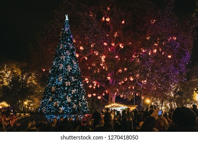 Vienna, Austria - November 25, 2018: People and decorations at Christmas World on Rathausplatz, traditional Christmas Market in Vienna with over 150 booths offering food and crafts.