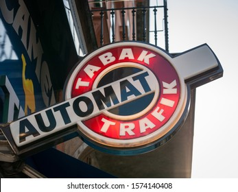 VIENNA, AUSTRIA - NOVEMBER 6, 2019: Austrian tobacconist sign, also called tabaktrafik automat, in the city center of Vienna. It is a typical design to show places selling cigarettes & tobacco product