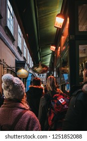 "Vienna, Austria - Novermber 24, 2018: People queuing to get into Figlmuller on Wollzeile restaurant in Vienna. Opened in 1905, it is often referred to as the ""Home of the Schnitzel""."