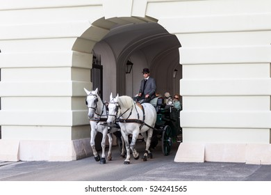 VIENNA AUSTRIA - OCT 16: Tourists aboard a horse carriage, touring the city center on October 16, 2016 in Vienna, Austria
