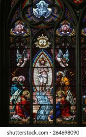 VIENNA, AUSTRIA - OCTOBER 10: Baptism of the Christ, Stained glass in Votiv Kirche (The Votive Church). It is a neo-Gothic church located on the Ringstrabe in Vienna, Austria on October 10, 2014