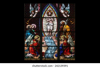 VIENNA, AUSTRIA - OCTOBER 11: Baptism of the Christ, Stained glass in Votiv Kirche (The Votive Church) in Vienna, Austria on October 11, 2014