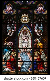 VIENNA, AUSTRIA - OCTOBER 11: Baptism of the Christ, Stained glass in Votiv Kirche (The Votive Church). It is a neo-Gothic church in Vienna, Austria on October 11, 2014