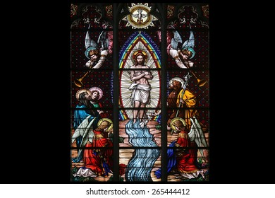 VIENNA, AUSTRIA - OCTOBER 11: Baptism of the Christ, Stained glass in Votiv Kirche (The Votive Church). It is a neo-Gothic church located on the Ringstrabe in Vienna, Austria on October 11, 2014