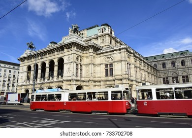 VIENNA, AUSTRIA - OCTOBER 13, 2017 - An old red Viennese tram in front of the famous Vienna State Opera