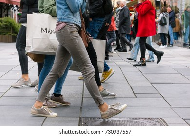 Vienna, Austria, October 2017: crowded shopping street with people carrying shopping bag. Shopping, Christmas gift, consumerism, holidays, spending photo concept.