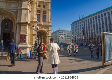 Vienna, Austria - October 2017: Street traffic and people walking in front of the Vienna State Opera building (Wiener Staatsoper was originally called the Vienna Court Opera Wiener Hofoper).