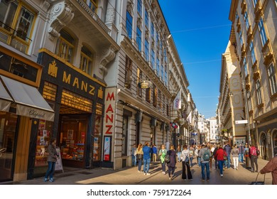 VIENNA, AUSTRIA - OCTOBER 2017: Walking by the crowded streets in the city center of Vienna, Austria. Colorful illuminated stores, shops and restaurants near Grabenstrasse. Vienna, Austria, Europe