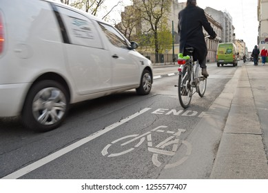 Vienna, Austria - October, 2018: Dangerous encounter between cyclists and cars at the end of a cycle path marked on street with much traffic. Conflict situation on a multi-used street.