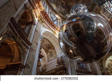 VIENNA, AUSTRIA - OCTOBER, 2019: Amazing interior with a golden sphere in Karlskirche church in Vienna
