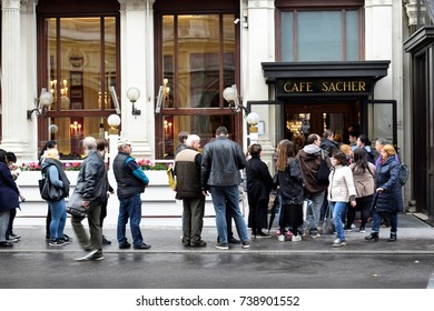 "VIENNA, AUSTRIA - OCTOBER 21, 2017: People waiting in a queue to enter ""Cafe Sacher"" which is famous for its chocolate cake"