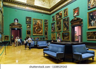 Vienna, Austria - October 22, 2017: Visitors in the Caravaggio Hall of Kunsthistorisches Museum or Museum of Art History