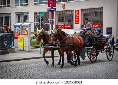 Vienna, Austria - October 30, 2007: Traditional horse riding in a Fiaker through the city center. Horse fiacre at Stephansplatz
