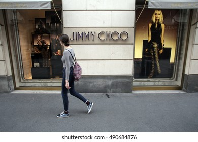 VIENNA, AUSTRIA, SATURDAY, SEPTEMBER 27, 2016: A young girl walks past a Jimmy Choo luxury shoe retail store.