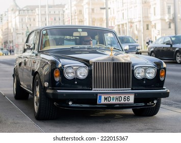 Vienna, Austria, Sep 24, 2014: luxury Rolls Royce Silver Shadow II car (released circa 1978 in England, UK) parked on Schwarzenbergplatz with an unidentified driver inside.