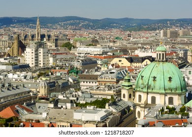 Vienna, Austria, September 09,2018:  Aerial view of Vienna with tower of the town hall building, votivkirche and peterskirche churches from the stephansdom cathedral.