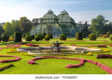 VIENNA, AUSTRIA - SEPTEMBER 11, 2016 : View of Palm House in Schonbrunn Palace Garden in Vienna, on bright sky background. It was built in 1883 and has many exotic plant and butterfly species.