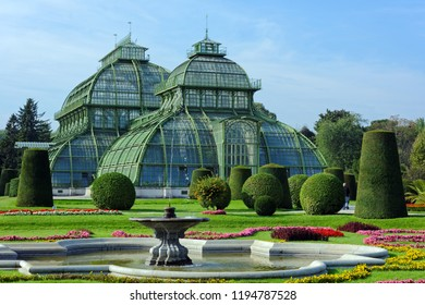 VIENNA, AUSTRIA - SEPTEMBER 17, 2018: Green house Palmenhaus Schonbrunn in Schonbrunn palace park. Opened in 1882, it is the most prominent of the four greenhouses in Schonbrunn Palace Park