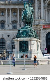 VIENNA, AUSTRIA - SEPTEMBER 17, 2018: Unknown people rest at monument to Prince Eugene of Savoy in front of Hofburg Palace, Vienna, Austria