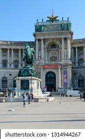 VIENNA, AUSTRIA - SEPTEMBER 17, 2018: Unidentified people are near monument to Prince Eugene of Savoy at Hofburg Palace, Vienna, Austria