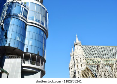 """VIENNA, AUSTRIA - SEPTEMBER 18, 2018: Modern and traditional architecture together in Vienna - Left: """"Haas Haus"""", Right: """"Stephansdom"""" (St. Stephen's Cathedral)"""