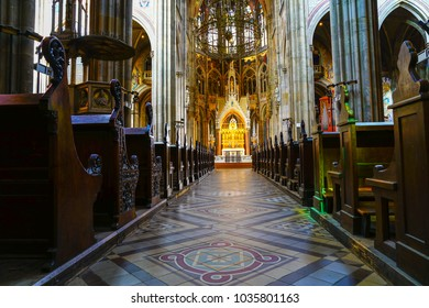 VIENNA, AUSTRIA - SEPTEMBER 2; Long aisle between rows of pews to golden statues behind alter in magnificent Votive September 2 2017 Vienna, Austria.