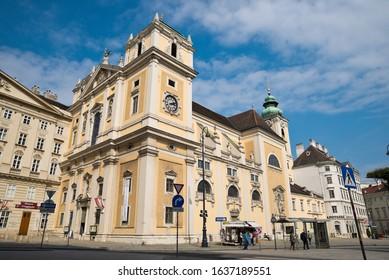 Vienna, Austria - September, 2019: Catholic baroque basilica Schottenkirche (Scots church) on the Freyung square on a beautiful summer day.