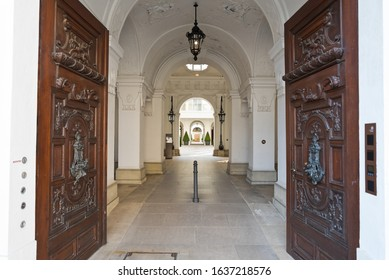 Vienna, Austria - September, 2019: Entrance door richly decorated and foyer to a historic palais in the old town.