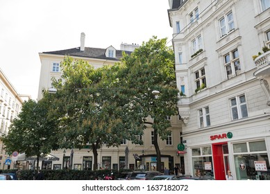 Vienna, Austria - September, 2019: Old town street with historic buildings and shady trees at Schottentor between Schottengasse and Mölker Steig.