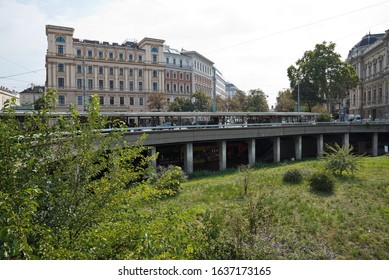 """Vienna, Austria - September, 2019: Schottentor traffic junction with the well-known passage called """"Jonasreindl"""" on the ring street also showing the university."""