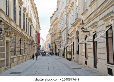 Vienna, Austria - September, 2019: View along pedestrian zone of Herrengasse street showing baroque houses in the old town.