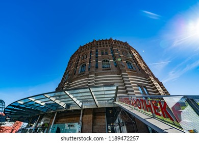 Vienna, Austria - September 26 2018: The Gasometer Buildings in Vienna, Austria are former natural gas storage facilities that were converted into shopping mall.