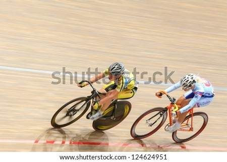 VIENNA,  AUSTRIA - SEPTEMBER 27  Lucie Zaleska (Czech Republic) and Alzbeta Pavlendova (Slovakia) compete in the women's scratch event of a cycling meeting on September 27, 2012 in Vienna, Austria.