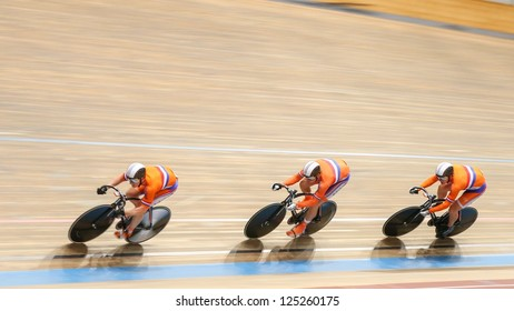 VIENNA,  AUSTRIA - SEPTEMBER 27  Matthihs Buechli, Hylke Grieken and Rigard Klooster (Netherlands) compete in the men's team sprint event of a cycling meeting on September 27, 2012 in Vienna, Austria.