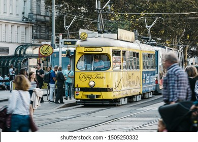 VIENNA, AUSTRIA - SEPTEMBER 28, 2018: Walking people and old style tram on the street of Vienna - federal capital and largest city of Austria, famous and popular tourist destination.
